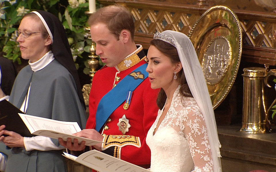 Photo - In this image taken from video, Britain's Prince William, left, sings with his wife, Kate, the Dutchess of Cambridge, at Westminster Abbey for the Royal Wedding in London on Friday, April, 29, 2011. (AP Photo/APTN) EDITORIAL USE ONLY NO ARCHIVE PHOTO TO BE USED SOLELY TO ILLUSTRATE NEWS REPORTING OR COMMENTARY ON THE FACTS OR EVENTS DEPICTED IN THIS IMAGE ORG XMIT: RWVM179