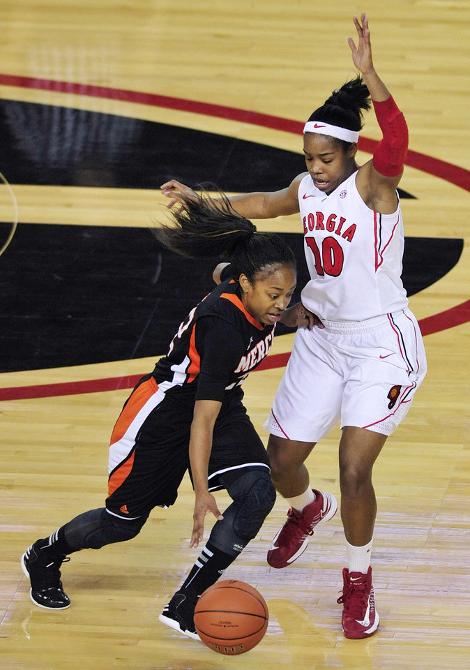 Georgia guard Jasmine James (10) pressures Mercer guard Sharnea Boykin (22) during the first half of an NCAA college basketball game, Tuesday, Dec. 4, 2012, in Athens, Ga. (AP Photo/Richard Hamm)