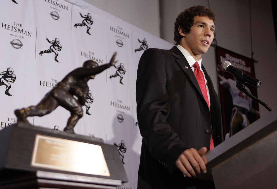 Photo - QUARTERBACK / OU / COLLEGE FOOTBALL / HEISMAN TROPHY WINNER / WIN: University of Oklahoma football player Sam Bradford answers questions for the media after being awarded the Heisman Trophy Saturday, Dec. 13, 2008 in New York.  (AP Photo/Julie Jacobson) ORG XMIT: NYJJ102