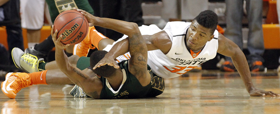Photo - South Florida Bulls' Anthony Collins (11) and Oklahoma State 's Marcus Smart (33) battle for a loose ball during the college basketball game between Oklahoma State University (OSU) and the University of South Florida (USF) on Wednesday , Dec. 5, 2012, in Stillwater, Okla.   Photo by Chris Landsberger, The Oklahoman