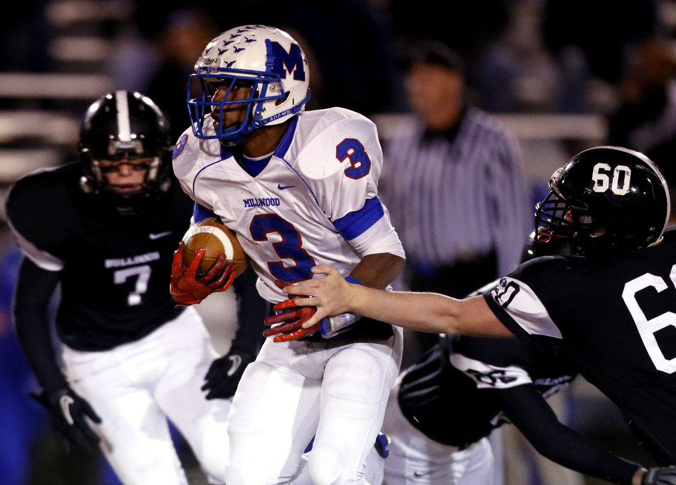 Photo - Millwood's Cameron Batson runs as the Millwood Falcons play the Meeker Bulldogs in state high school football playoffs on Friday, Nov. 29, 2013, in Meeker, Okla.  Photo by Steve Sisney, The Oklahoman