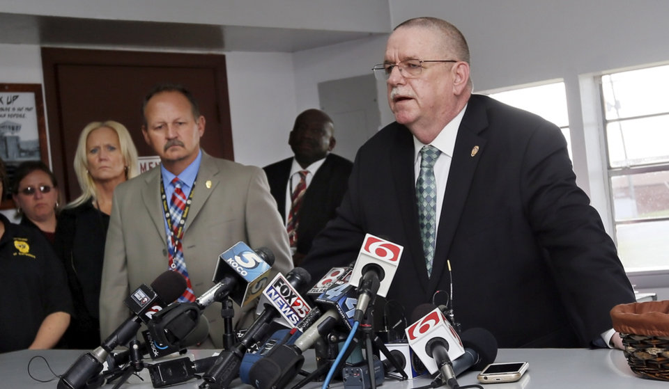 Photo - Robert Patton, director of the Department of Corrections, addresses the media after the scheduled execution of Richard Eugene Glossip was stayed at the Oklahoma State Penitentiary in McAlester, Okla., Wednesday, Sept. 30, 2015. Gov. Fallin stayed the execution for 37 days. Photo by Nate Billings, The Oklahoman