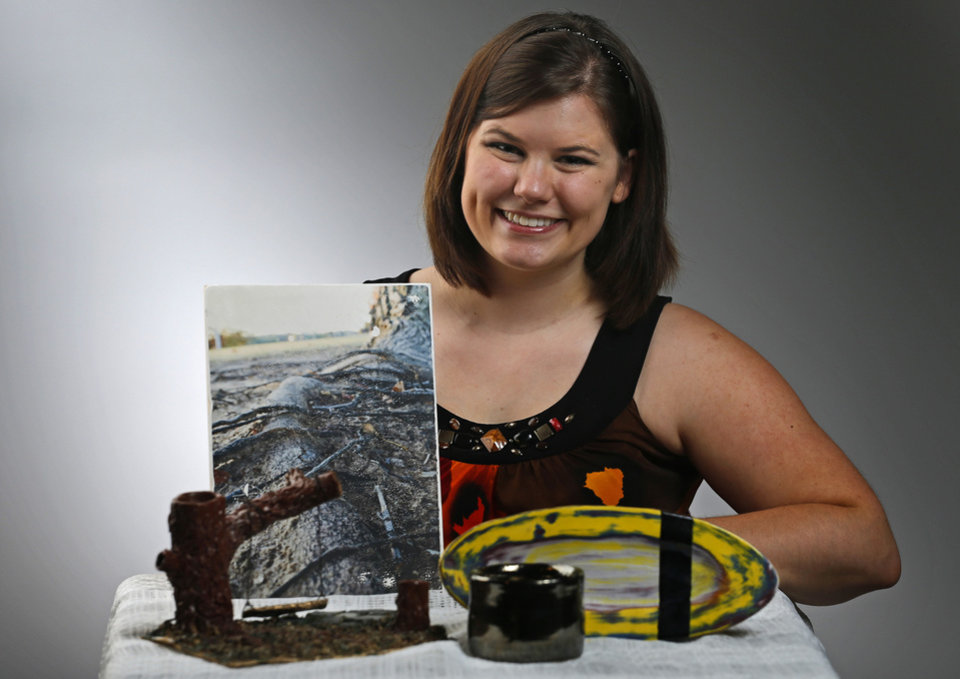 Photo - Amanda Meyer poses with some of her ceramic creations and a photographic transfer. Photo by Bryan Terry, The Oklahoman.  BRYAN TERRY