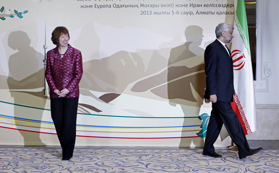 EU foreign policy chief Catherine Ashton, left, smiles, as Secretary of Iran's Supreme National Security Council Saeed Jalili walks away, after a photo call at a start of high-level talks between world powers and Iranian officials in Almaty, Kazakhstan on Friday, April 5, 2013. (AP Photo/Shamil Zhumatov, Pool)