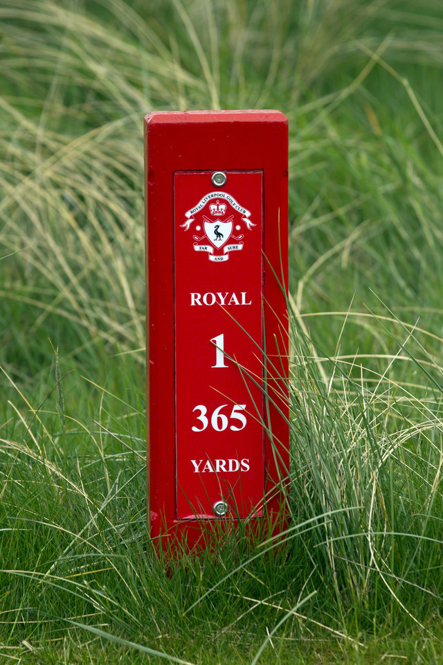 Photo - FILE - This April 23, 2014, file photo, shows a yardage marker showing the distance on the first hole at Royal Liverpool Golf Club in Hoylake, England. The British Open golf championship begins on Thursday July 17, 2014. (AP Photo/Jon Super, File)