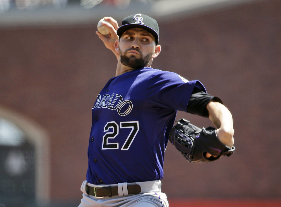 Photo - Colorado Rockies starting pitcher Tyler Chatwood throws to the San Francisco Giants during the first inning of a baseball game on Sunday, April 13, 2014, in San Francisco. (AP Photo/Marcio Jose Sanchez)