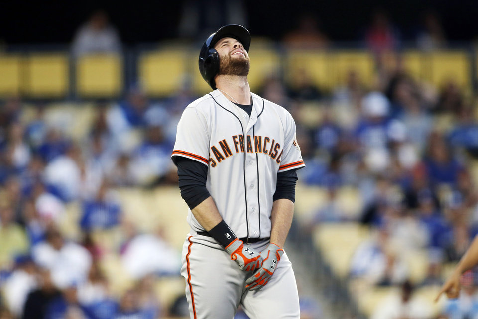 Photo - San Francisco Giants' Brandon Belt reacts after being hit by a pitch on his left hand against the Los Angeles Dodgers during the second inning of a baseball game, Friday, May 9, 2014, in Los Angeles. (AP Photo/Danny Moloshok)