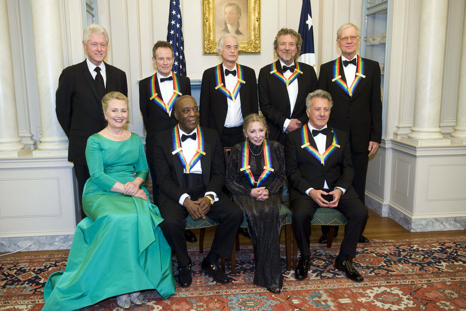Photo - From left, former President Bill Clinton, Secretary of State Hillary Rodham Clinton join the 2012 Kennedy Center Honorees John Paul Jones, Buddy Guy, Jimmy Page, Natalia Makarova, Robert Plant, Dustin Hoffman, and David Letterman for a group photo after the State Department Dinner for the Kennedy Center Honors gala Saturday, Dec. 1, 2012 at the State Department in Washington. (AP Photo/Kevin Wolf)