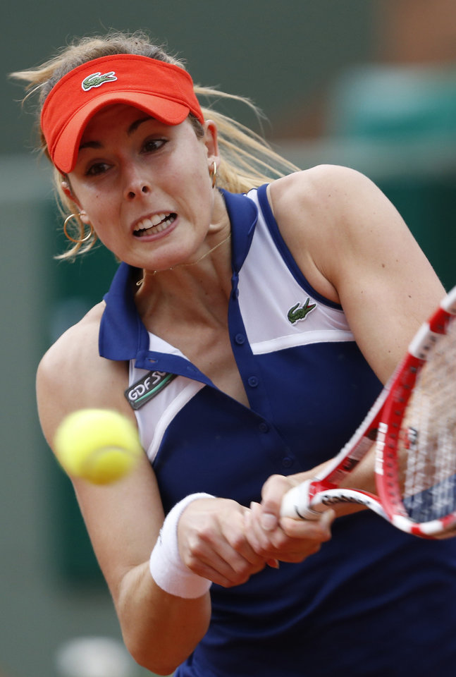 Photo - France's Alize Cornet returns the ball to Taylor Townsend, of the U.S, during the second round match of  the French Open tennis tournament at the Roland Garros stadium, in Paris, France, Wednesday, May 28, 2014. (AP Photo/Darko Vojinovic)