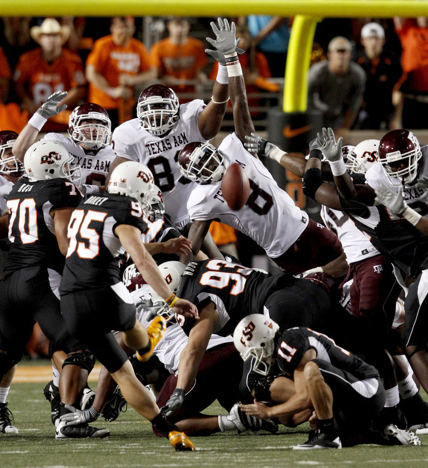 Photo - OSU's Dan Bailey makes the game-winning field goal during the college football game between Texas A&M University and Oklahoma State University (OSU) at Boone Pickens Stadium in Stillwater, Okla., Thursday, Sept. 30, 2010. Photo by Bryan Terry, The Oklahoman