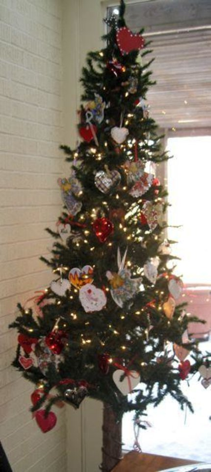 Photo - FRIENDS CELEBRATE JANUARY....A tree held heart decorations in the  home of Ranell Brown. (Photo by Helen Ford Wallace).