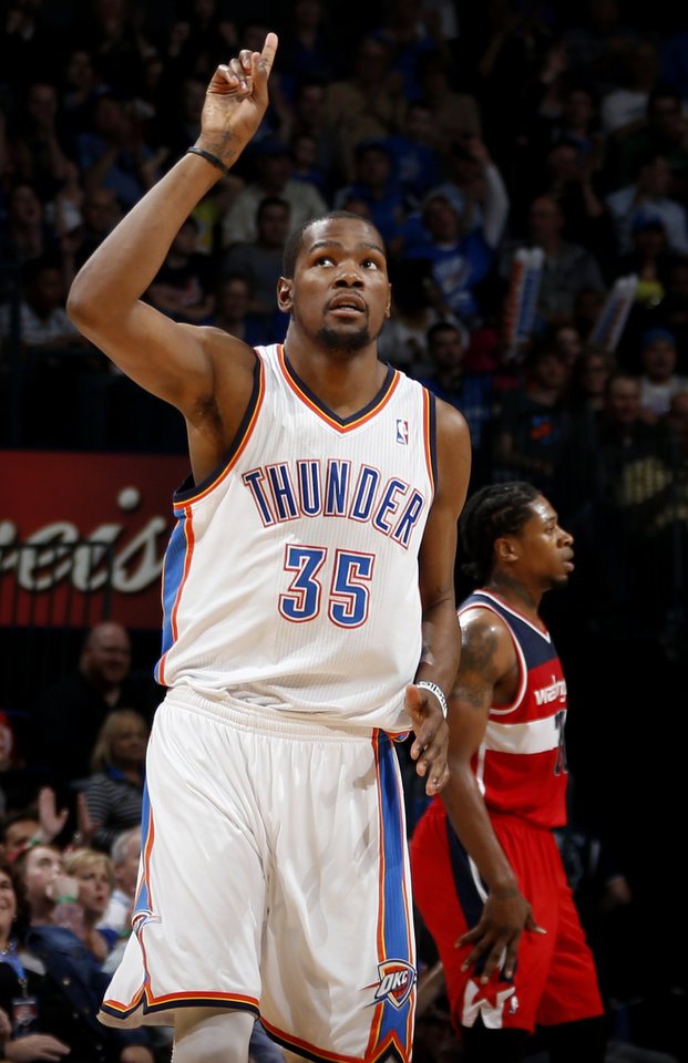 Oklahoma City's Kevin Durant (35) reacts after a basket during an NBA basketball game between the Oklahoma City Thunder and the Washington Wizards at Chesapeake Energy Arena in Oklahoma City, Wednesday, March 19, 2013. Oklahoma City won 103-80. Photo by Bryan Terry, The Oklahoman