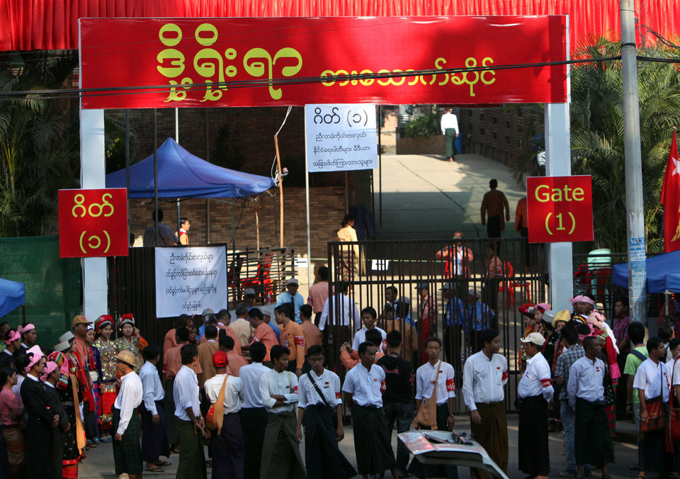 Photo - Members of Myanmar opposition leader Aung San Suu Kyi's National League for Democracy (NLD) party gather outside a venue for their first ever congress of the party at Royal Rose restaurant in Yangon, Myanmar, Saturday, March. 9, 2013. The NLD is holding an all-party congress to elect its own leadership for the first time in the group's 25-year history— an important step toward making it more reflective of its democratic ideals. It is a sign of how far Myanmar has come with political reform that the gathering is allowed at all. But it's also a test for the NLD, which is working to transform itself from a party of one into a structurally viable political opposition in time for national elections in 2015. (AP Photo/Khin Maung Win)