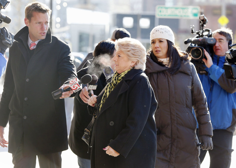 Photo - Patricia Donahue, wife of Michael Donahue, center, arrives for James