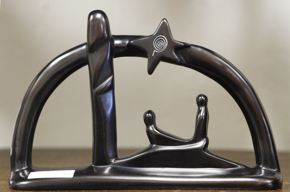 This arched Nativity sculpture from Kenya is one of the items for sale at  Pambe Ghana Global Market. Photo By David McDaniel, The Oklahoman. <strong>David McDaniel - The Oklahoman</strong>