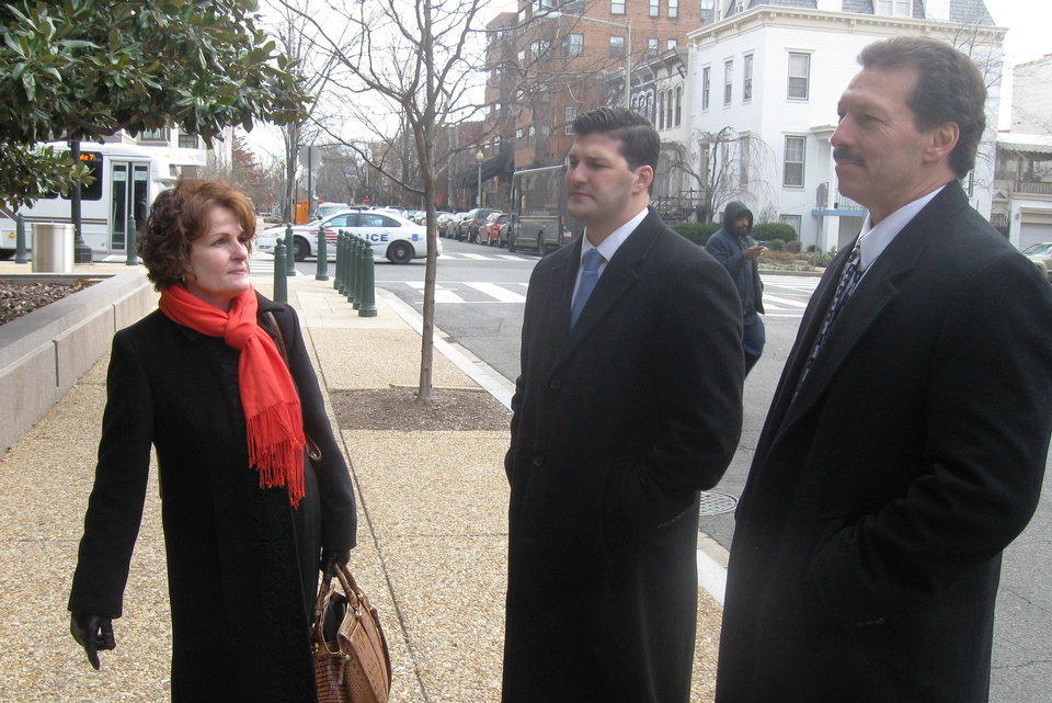 Photo - From left, Vicki Behenna, Brett Behenna and Scott Behenna talk Thursday on Capitol Hill in Washington after a parole hearing in nearby Arlington, Va., for 1st Lt. Michael Behenna. PHOTO BY CHRIS CASTEEL, THE OKLAHOMAN  Chris Casteel - The Oklahoman