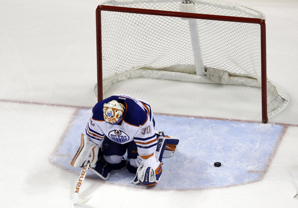 Photo - FILE - In this March 13, 2014, file photo, Edmonton Oilers goalie Ben Scrivens is slow to get up after giving up a goal to St. Louis Blues' Jaden Schwartz during the third period of an NHL hockey game in St. Louis. For the first time since 1973, there is just one Canadian team in the NHL postseason. The Montreal Canadiens represent the nation's only hope of ending a 21-year Stanley Cup drought. (AP Photo/Jeff Roberson, File)