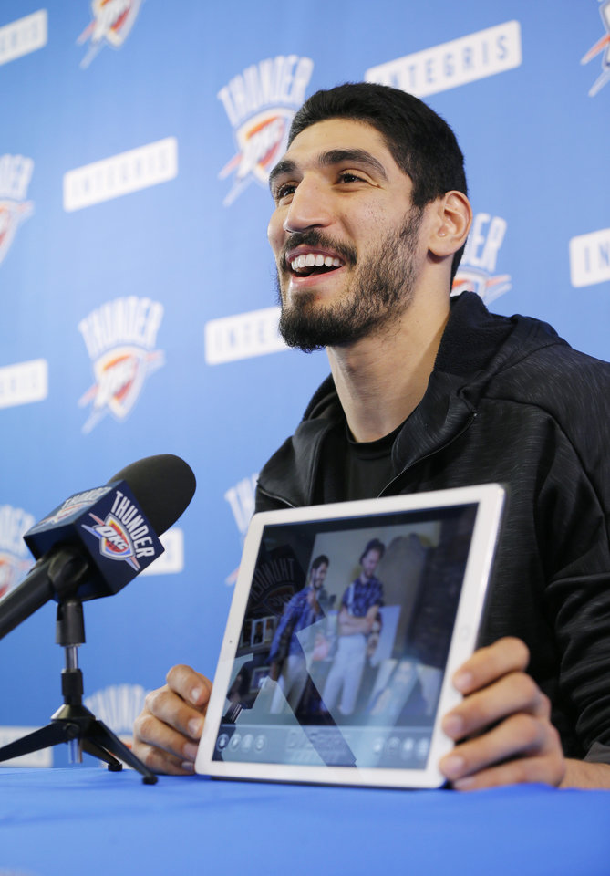 Photo - Enes Kanter shows bloopers from the internet videos he and Steven Adams made with teammates to promote Russell Westbrook for NBA MVP, during exit interviews for the Oklahoma City Thunder at the Integris Thunder Development Center in Oklahoma City, Wednesday, April 26, 2017. Photo by Nate Billings, The Oklahoman