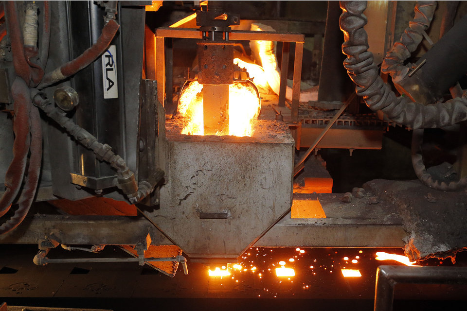 Photo - Molten metal is cast at Rochester Metal Products Corp. in Rochester, Ind.  AJ Mast -  AP