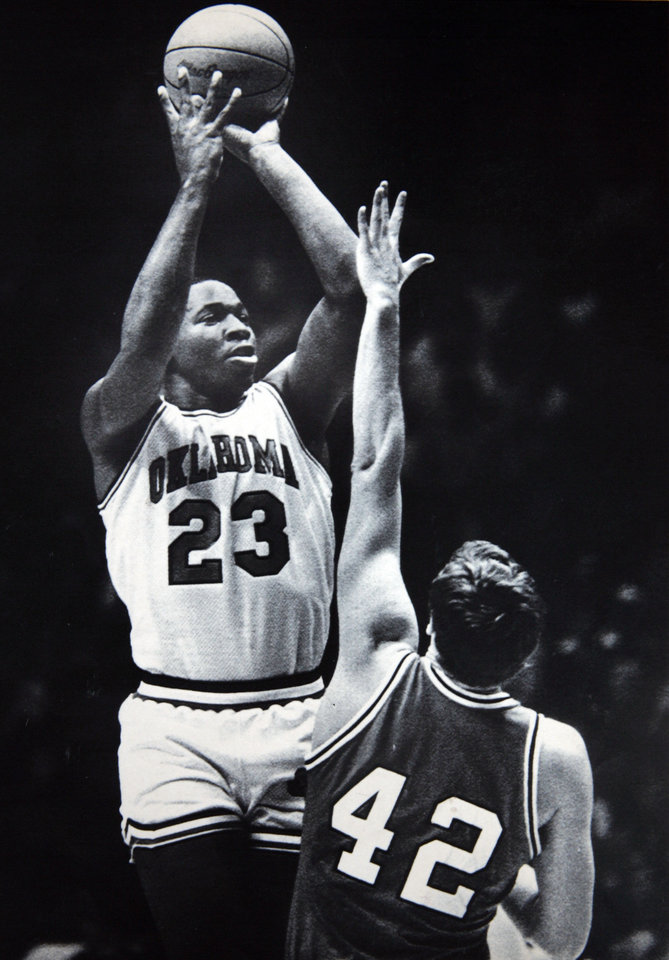 Former OU basketball player Wayman Tisdale. NORMAN, Okla., Feb. 6-UP WITH THE SHOT--University of Oklahoma center Wayman Tisdale, 23, goes up with a shot as University of Nebraska center Dave Hopen, 42, goes for the block during first half action Wednesday night in Norman,Okla. The seventh-ranked Sooners led the Cornhuskers 49-31 at the half. (AP Laserphoto) Photo taken 2/6/1985, Photo published 2/12/1985, 7/5/1992 in The Daily Oklahoman. ORG XMIT: KOD