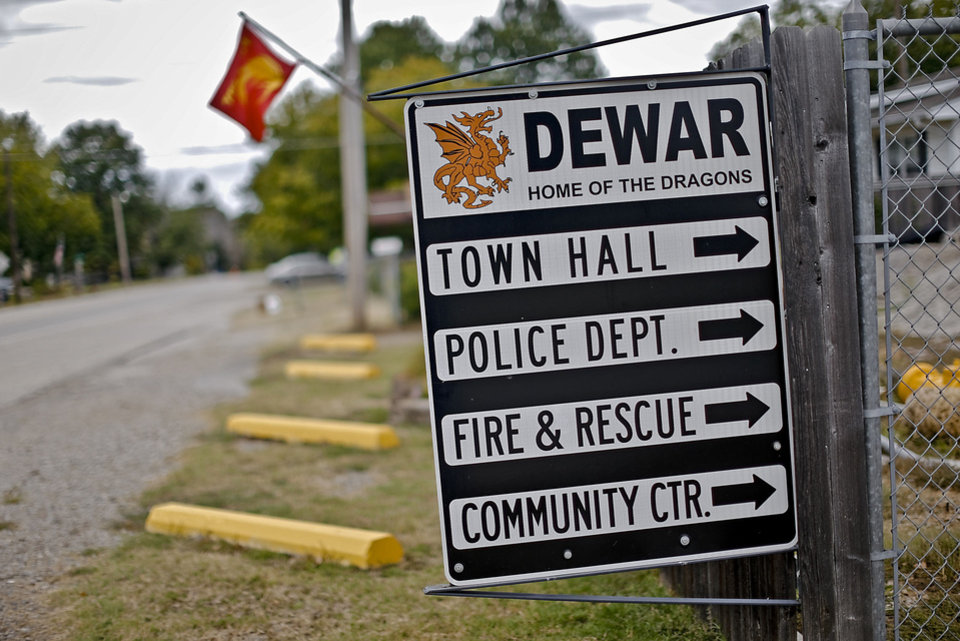Photo - Directional signs in Dewar, Okla.  Residents of the town have responded to secretive municipal governments by getting a state audit through a petition in Dewar, Okla. on Thursday, July 26, 2012.   Photo by Chris Landsberger, The Oklahoman
