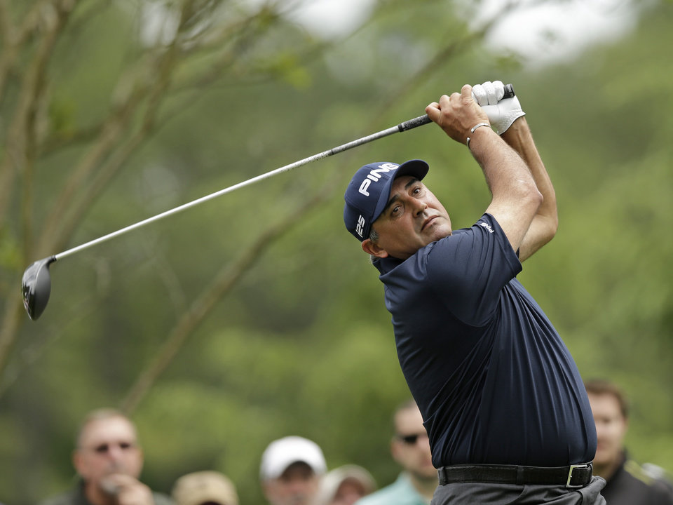 Angel Cabrera, of Argentina, watches his tee shot on the 11th hole during the second round of the Wells Fargo Championship golf tournament in Charlotte, N.C., Friday, May 2, 2014. (AP Photo/Chuck Burton)