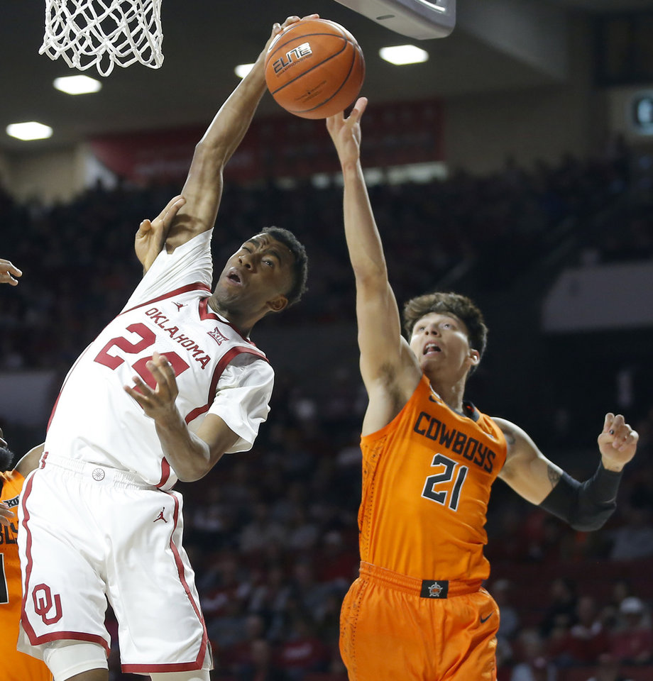 Photo - Oklahoma's Jamal Bieniemy (24) reaches for the ball in front of Oklahoma State's Lindy Waters III (21) during a Bedlam college basketball game between the University Oklahoma Sooners (OU) and the Oklahoma State Cowboys (OSU) at the Lloyd Noble Center in Norman, Okla., Saturday, Feb. 1, 2020. [Bryan Terry/The Oklahoman]