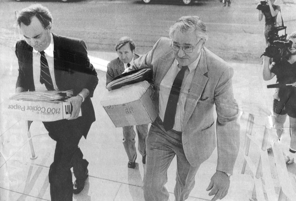 Photo - Defense attorneys (for Oklahoma House Majority Floor Leader Joe Fitzgibbon), from left, Gene Stipe, Eddie Harper (rear) and Bruce Green are pictured ealier this week entering the U.S. District Courthouse in Muskogee.  Stipe left to join his family on vacation in Amsterdam a few hours before the case went to the jury and the gulity verdicts were subsequently announced.  Fitzgibbon and House Speaker Dan Draper were found guilty by a federal court jury Thursday night (8/18/83) of charges they participated in a fraudulant absentee ballots scheme.  Staff photo by Paul S. Howell; photo ran in the 8/19/83 Daily Oklahoman.