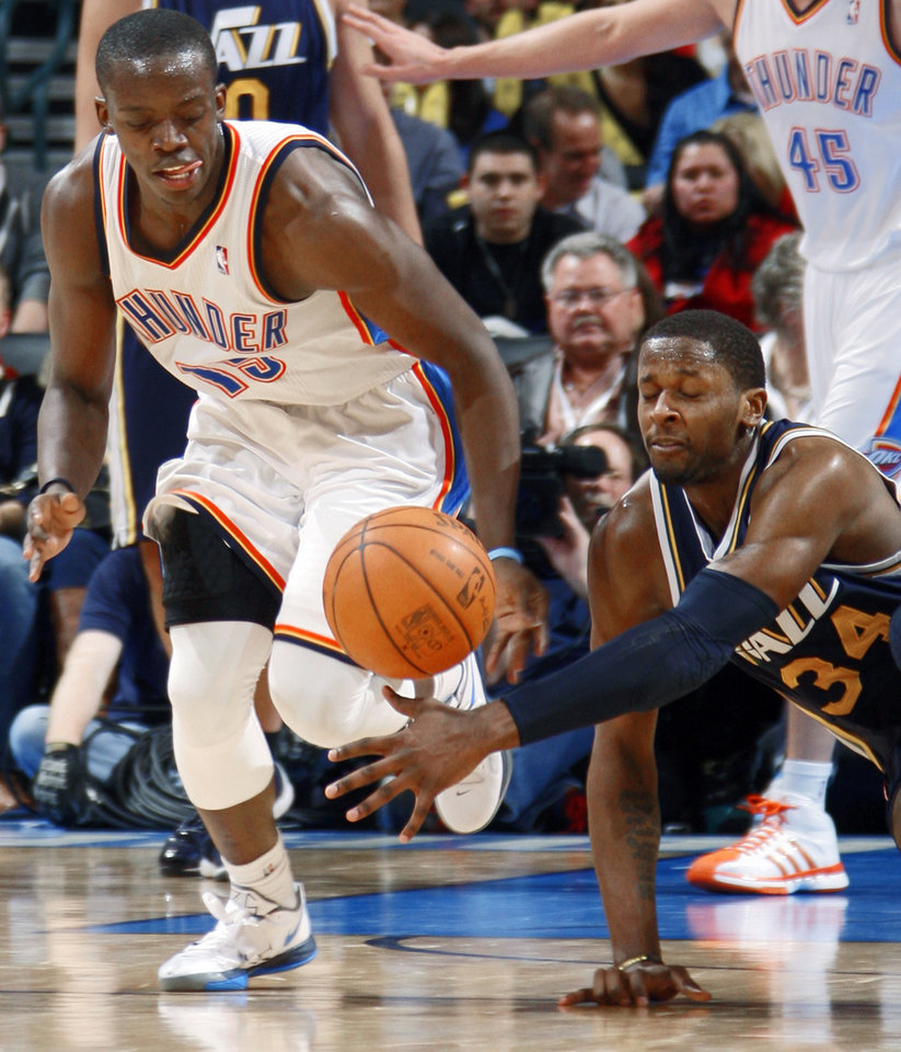 Oklahoma City's Reggie Jackson (15) goes for the ball beside Utah's C.J. Miles (34) during an NBA game between the Oklahoma City Thunder and the Utah Jazz at Chesapeake Energy Arena in Oklahoma CIty, Tuesday, Feb. 14, 2012. Photo by Bryan Terry, The Oklahoman