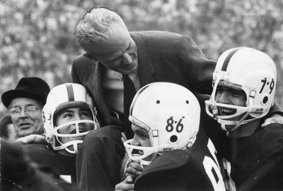 Photo - Head football coach Bud Wilkinson is carried off the field by his Sooners after they defeated Nebraska in 1962. (Oklahoman Archives)
