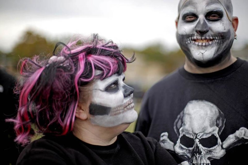 Photo -  Dianna and Pete Rustin wait in line for their skeleton suit before the March of 1,000 Flaming Skeletons during the Ghouls Gone Wild Halloween Parade in Oklahoma City, Saturday, October 24, 2009. Photo by Bryan Terry, The Oklahoman