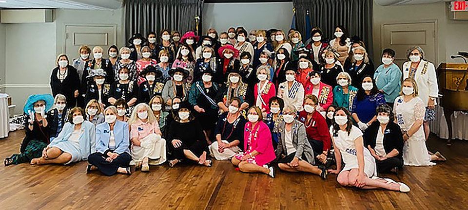 Photo - DAR members and pages wearing masks that were sewn and gifted by Cindy Henderson. PHOTO BY KIRSTEN FERATE