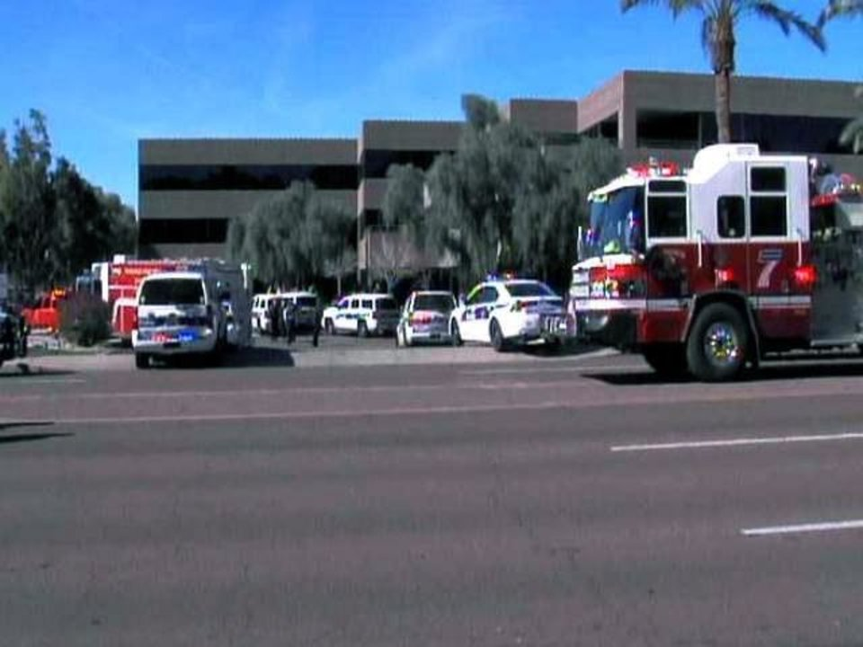 This frame grab provided by abc15.com shows the scene at a Phoenix office complex where police say a gunman shot at least three people on Wednesday, Jan. 30, 2013. Officer James Holmes said the victims were taken to hospitals and did not know if their injuries were life threatening. (AP Photo/abc15.com) MANDATORY CREDIT  ORG XMIT: NY121
