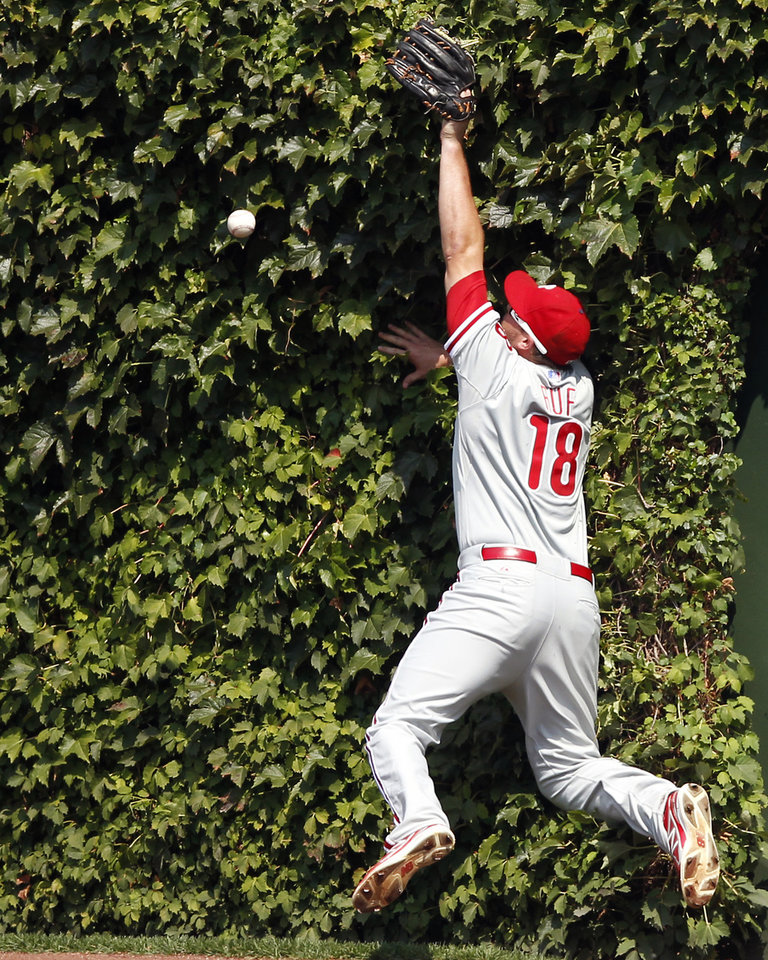 Photo - Philadelphia Phillies right fielder Darin Ruf misses the catch on a double hit by the Chicago Cubs' Anthony Rizzo during the third inning of a baseball game on Sunday, Sept. 1, 2013, in Chicago. (AP Photo/Andrew A. Nelles)