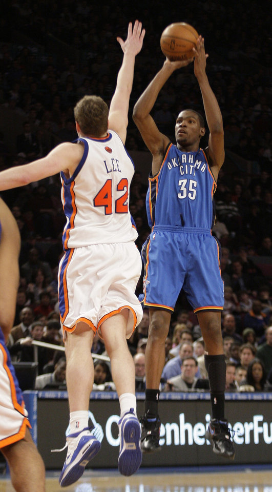 Photo - Oklahoma City Thunder's Kevin Durant (35) shoots over New York Knicks' David Lee (42) during the second half of an NBA basketball game  Saturday, Feb. 20, 2010  in New York. The Thunder won the game 121-118. (AP Photo/Frank Franklin II) ORG XMIT: MSG105