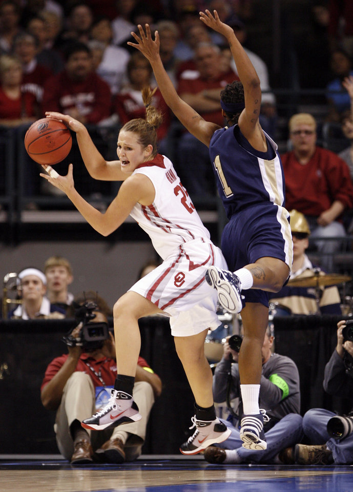 Whitney Hand rebounds past Shavonte Zellous in the first half of the NCAA women's basketball tournament game between the University of Oklahoma and Pittsburgh at the Ford Center in Oklahoma City, Okla. on Sunday, March 29, 2009. 