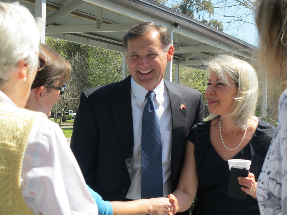 Photo - Former Charleston County Councilman Curtis Bostic  and his wife, Jenny, greet voters at a polling place in Charleston, S.C., on Tuesday, April 2, 1013. Bostic faced former South Carolina Gov. Mark Sanford on Tuesday in the Republican primary  runoff for South Carolina's vacant 1st District congressional seat.  (AP Photo/Bruce Smith)
