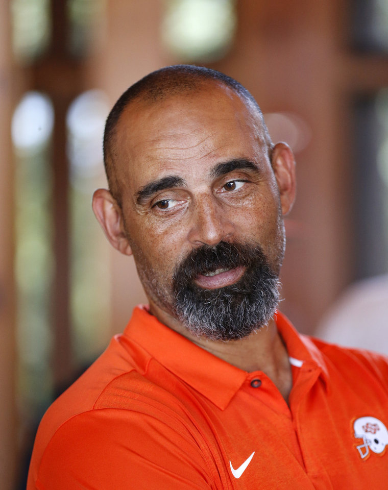 Photo - Oklahoma State associate head coach and receivers coach Kasey Dunn speaks to the media after the OSU football media golf scramble at Karsten Creek Golf Club in Stillwater, Okla., Monday, July 29, 2019. [Nate Billings/The Oklahoman]