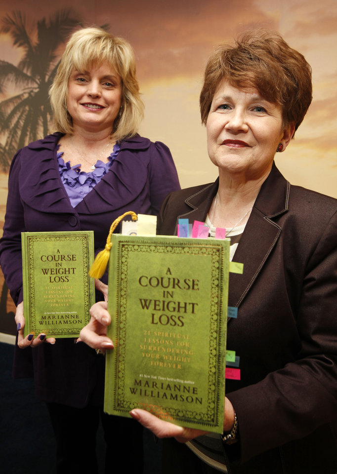 "Photo - Debi Dunbar Mahoney, left, and Annette Murphy pose with a copy of ""A Course in Weight Loss"" at Unity Church, 5603 NW 41. They will teach a class based on the book beginning Jan. 30 at the Warr Acres church. Photo by Steve Gooch, The Oklahoman"