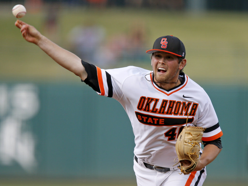 Photo - OSU's Jon Perrin pitches during a Bedlam baseball game between the University of Oklahoma and Oklahoma State University at Chickasaw Bricktown Ballpark in Oklahoma City, Thursday, May 15, 2014. Photo by Bryan Terry, The Oklahoman