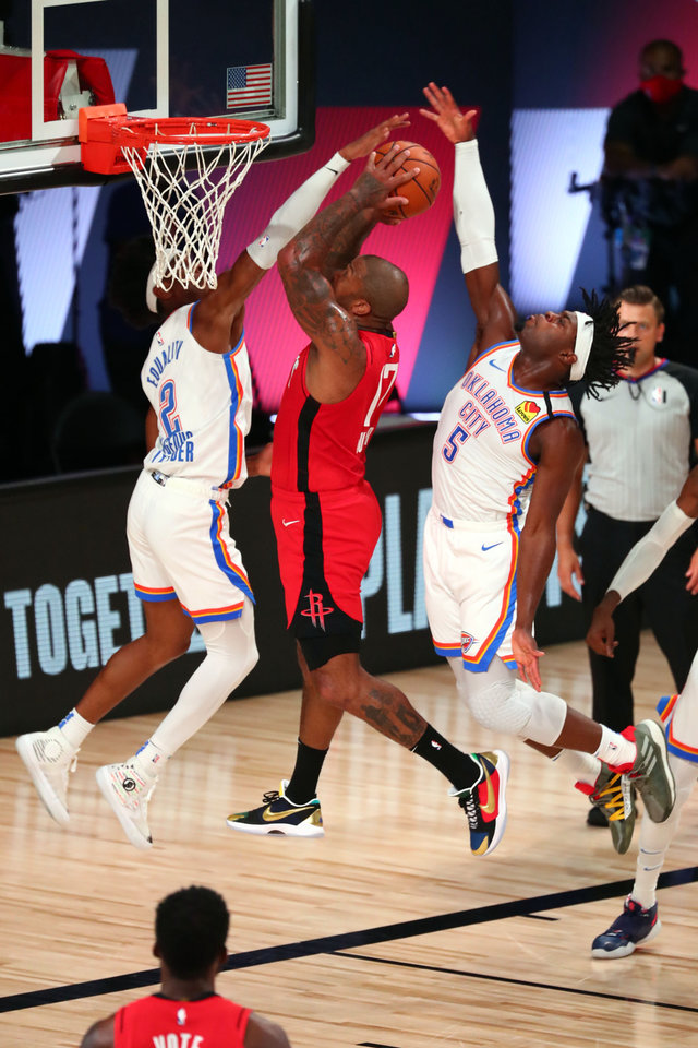 Photo - Aug 20, 2020; Lake Buena Vista, Florida, USA; Houston Rockets forward P.J. Tucker (17) shoots the ball against Oklahoma City Thunder guard Shai Gilgeous-Alexander (2) and guard Luguentz Dort (5) during the second quarter in an NBA basketball first round playoff game of the 2020 NBA playoffs at AdventHealth Arena. Mandatory Credit: Kim Klement-USA TODAY Sports