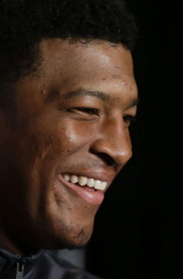 Photo - Florida State quarterback Jameis Winston answers questions during a news conference on Friday, Jan. 3, 2014 in Newport Beach, Calif. Florida State is scheduled to play Auburn on Monday, in the BCS national championship NCAA college football game. (AP Photo/Chris Carlson)