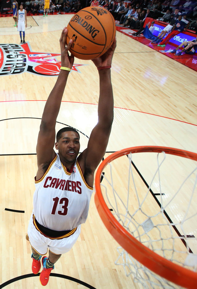 Team Chuck's Tristan Thompson, of the Cleveland Cavaliers, dunks against Team Shaq during the first half of the Rising Stars Challenge basketball game at NBA All-Star Weekend Friday, Feb. 15, 2013, in Houston. (AP Photo/Ronald Martinez)
