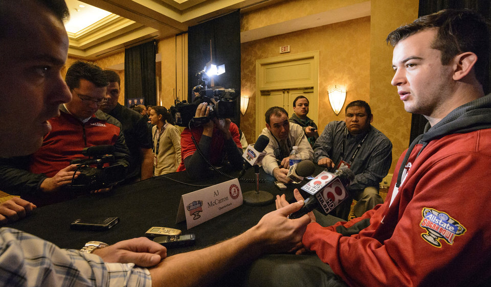 Photo - Alabama quarterback AJ McCarron talks with the media during an NCAA college football news conference, Sunday, Dec. 29, 2013, at the New Orleans Marriott Conventions Center in New Orleans. Alabama plays Oklahoma in the Sugar Bowl on Thursday, Jan.  2, 2014.(AP Photo/AL.com Vasha Hunt) MAGS OUT