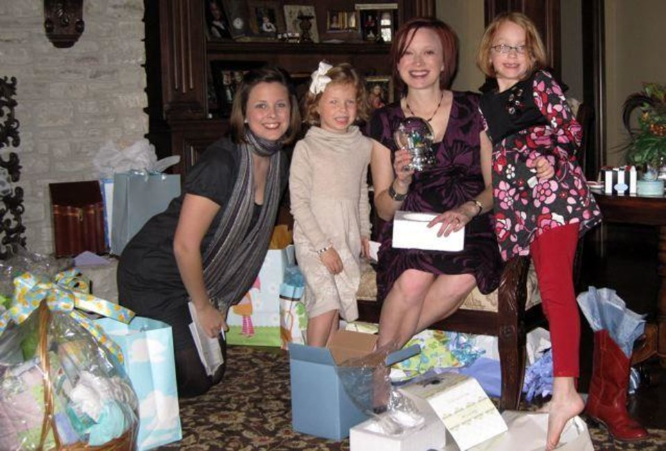 HE'S A BOY....Karen Brown, Tierney Cash, Kirsten Cash and McKenna Cash open gifts at the baby shower for Kirsten Cash who is having a   baby boy in January. She was the honoree at a baby shower. (Photo by Helen Ford Wallace).