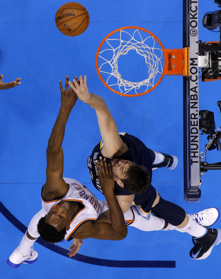 Photo - Oklahoma City's Hasheem Thabeet (34) goes for the rebound beside Memphis' Marc Gasol (33) during Game 2 in the second round of the NBA playoffs between the Oklahoma City Thunder and the Memphis Grizzlies at Chesapeake Energy Arena in Oklahoma City, Tuesday, May 7, 2013. Photo by Bryan Terry, The Oklahoman