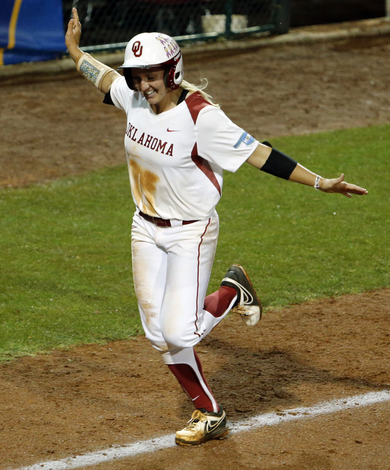 Photo - Oklahoma's Shelby Pendley comes home after a home run as the University of Oklahoma Sooner (OU) softball team plays Tennessee in the first game of the NCAA super regional at Marita Hynes Field on May 23, 2014 in Norman, Okla. Photo by Steve Sisney, The Oklahoman
