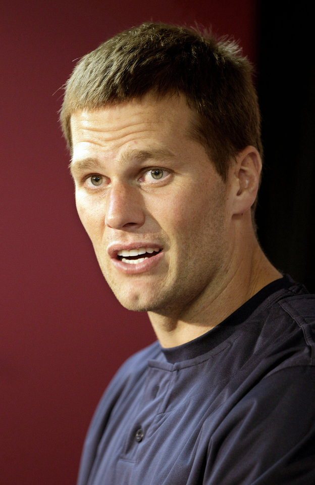 Photo -   New England Patriots quarterback Tom Brady speaks during a media availability at the NFL football team's facility in Foxborough, Mass., Wednesday, Oct. 3, 2012. (AP Photo/Stephan Savoia)