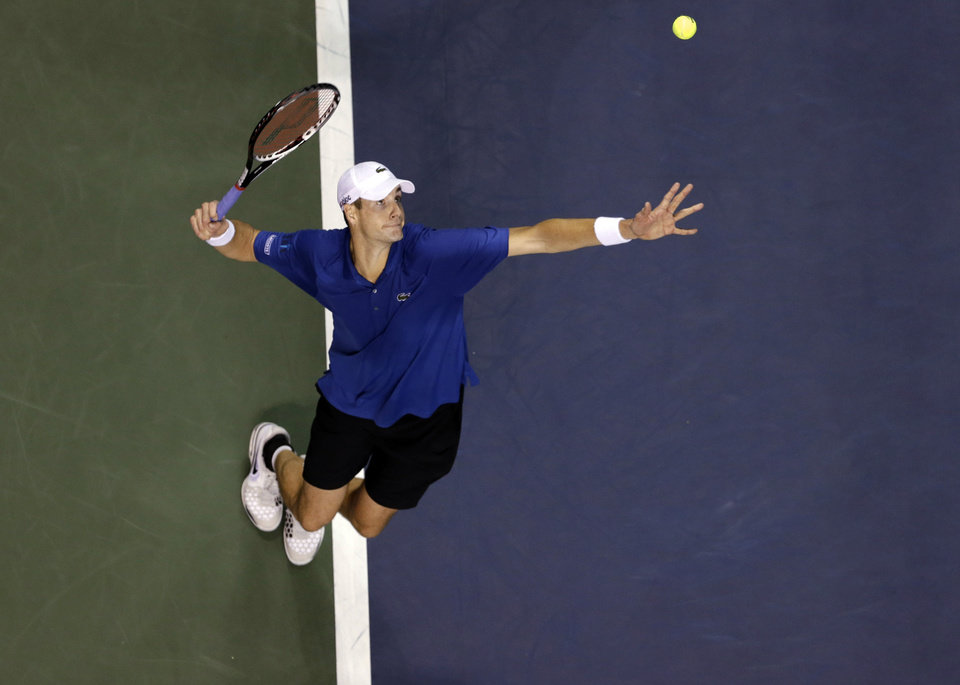 John Isner, of the United States, serves to Xavier Malisse, of Belgium, at the SAP Open tennis tournament in San Jose, Calif., Friday, Feb. 15, 2013. Isner won 7-6 (8), 6-2. (AP Photo/Marcio Jose Sanchez)