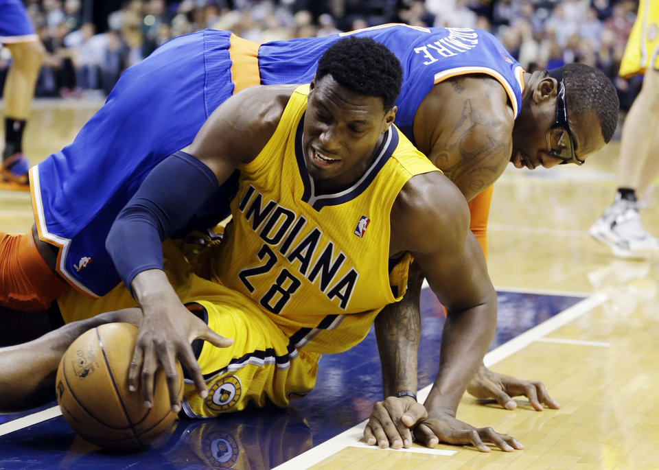 Indiana Pacers' Ian Mahinmi (28) and New York Knicks' Amare Stoudemire (1) battle for a loose ball during the first half of an NBA basketball game, Thursday, Jan. 10, 2013, in Indianapolis. (AP Photo/Darron Cummings)